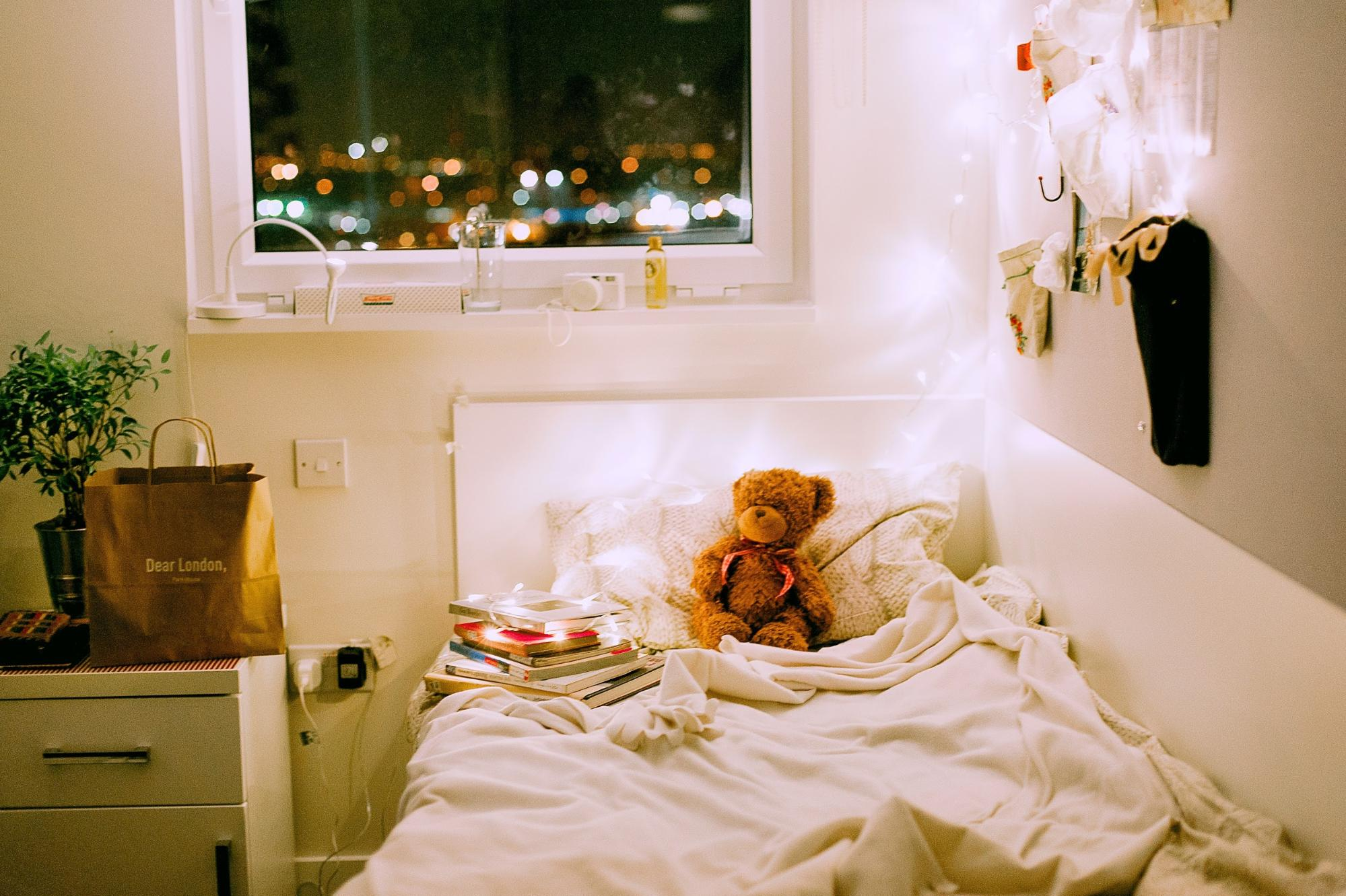 decorating your dorm room with lights and a teddy bear