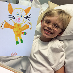 Reid with his cat drawing for plush creation