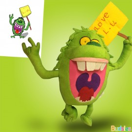 green stuffed animal monster with yellow sign