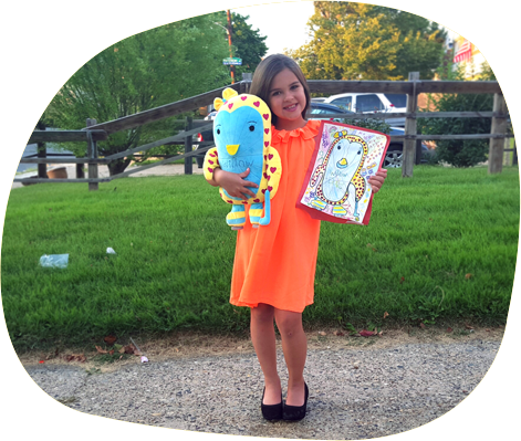 Adorable girl with her custom plush bird and drawing